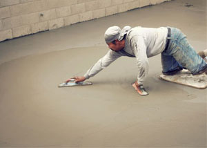 smoothing out the grout in a slab releveling project in Modesto