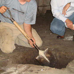 Digging a hole for the engineered fill used in a crawl space support system installation in Modesto