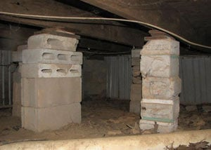 crawl space repairs done with concrete cinder blocks and wood shims in a Redwood City home