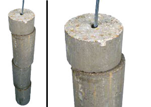 A cutaway image of concrete piers string along a wire, intended for foundation repairs.