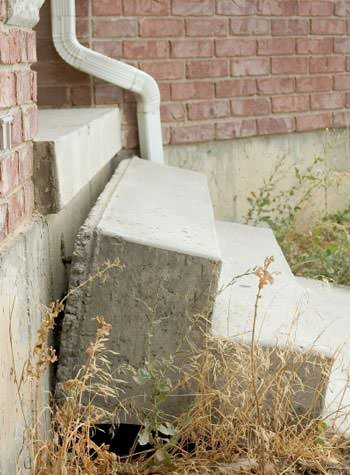sinking outdoor concrete steps showing cracking and soil washout in San Leandro