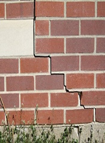 photo of a rotating foundation wall with cracks in Pittsburg