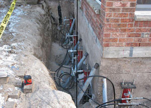 Foundation push piers installed around a house with a foundation settlement issues in Pittsburg