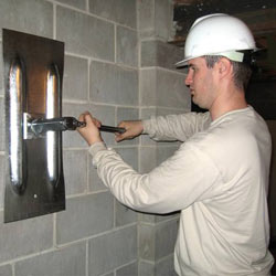 installing a wall anchor to repair a bowing foundation wall in Hayward