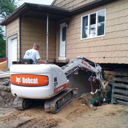 Excavating to expose the foundation walls and footings for a replacement job in Sunnyvale