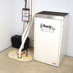 Sump pump system, dehumidifier, and basement wall panels installed during a sump pump installation in Concord